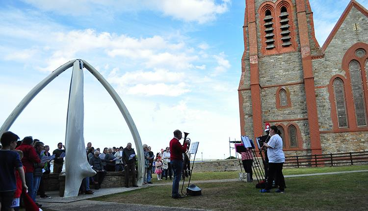 Christmas Carols under the Whalebone Arch